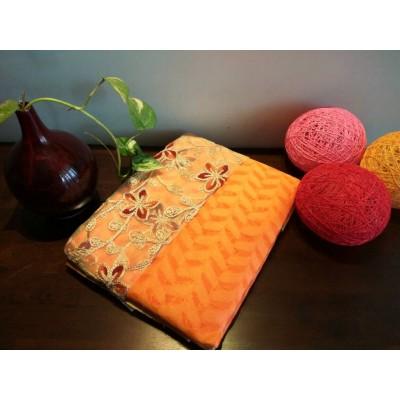 Ameya Orange Jute Patola with Net Designer Blouse